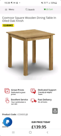 Coxmoor solid oak dining table New in box