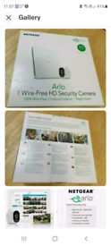 Arlo wireless wifi security system. Plus battery charger.