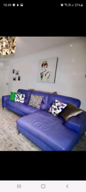 Purple leather 4 seater chaise sofa with chair and footstool.