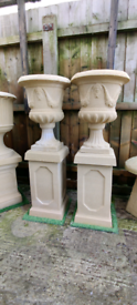 Very heavy stone urns on large plinths x2