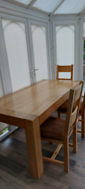 Solid oak 6 seater dining table and 6 chairs