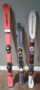 ADULT DOWNHILL SKIS.