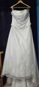 Wedding dress, never worn/altered. Retail for $2000 asking $600