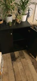 Black cabinet storage cabinet with shelf