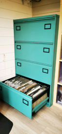Four drawer side filing cabinet in Teal powedercoat finish