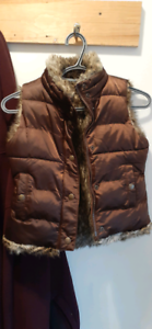 Girls winter vest fauz fur inside  or out wear. Great condition