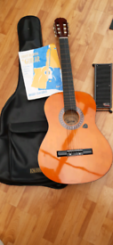 Acoustic Guitar, with case, footrest and beginners book.