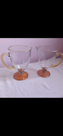 Two Heavy Coloured Glass Drinks Serving Jugs