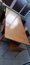 Pine dining table and 8 chairs