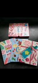 Set of 3 books in case