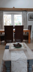 Dining table with 6 wicker chairs