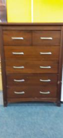 Dark wood chest of drawers