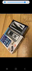 Digital voice recorder and separate microphone unopened