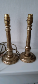Pair of gold, bronze coloured lamp bases.