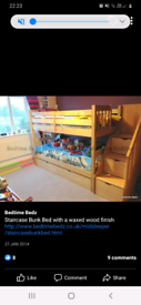 Wooden bunk bed with side stairs and storage