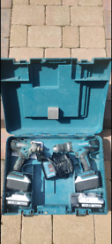 2 Makita screw guns, 2 X 4ah batteries 2 X 1.5ah batteries and charger