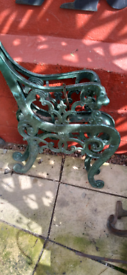 Heavy cast iron bench ends with lions head arms