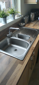 Metal double sink with adjustable tap