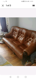 Leather 3 piece suite with carved hardwood base