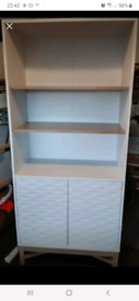 Tall white unit with shelves and cupboard