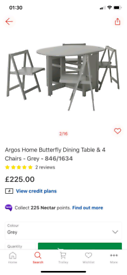 Grey butterfly Dining table with 4 folding Chairs £150. Real Bargains