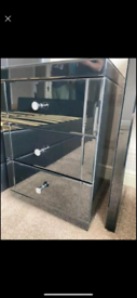 Black mirrored glass bedside drawers