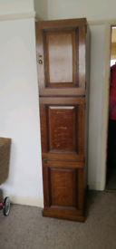 Antique solid wood tall cupboard with hanging rail.