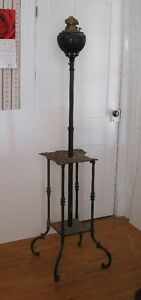 Antique parlor or piano brass oil lamp on cast iron stand