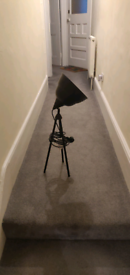 Pair of black tripod lamps