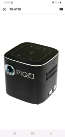 PIQO SMART MINI PROJECTOR. BRAND NEW BOXED SEALED