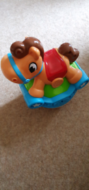 Leap frog rocking horse toy with lights and sounds push along