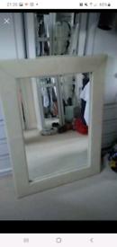 Cream leather wall mirror