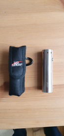 LED Lenser handheld torch and pouch (collection only)