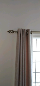 Antique brass curtain rails and table lamps
