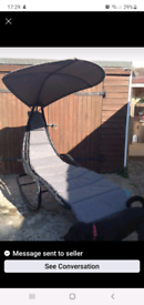 Rocking garden chair with over head canopy