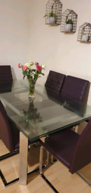 A stylish dining table with six chairs
