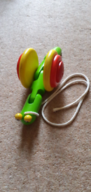 Wooden snail pull along toy