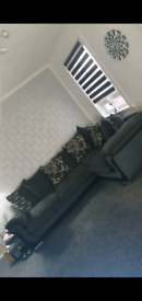 Grey scatter back corner couch with pull out sofa bed