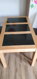 solid wood table with granite inserts