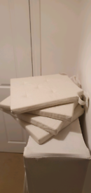 4 x almost new dining chair cushions