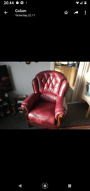 Burgundy leather three seater and one chair
