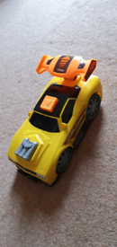 Large yellow charge and release race car.
