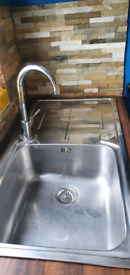 Stainless steel mixer tap and sink/drainer.