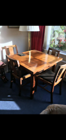 Extendable solid wooden dining table and 6 chairs