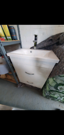 Hand basin, vanity unit and mixer tap