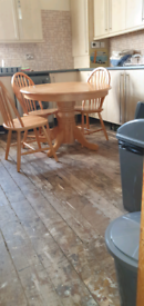 Pine round kitchen table with four spindle back chairs in ex condition