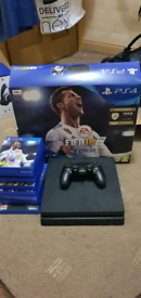 PS4 Slim for sale fully boxed £180 Comes with 11 games