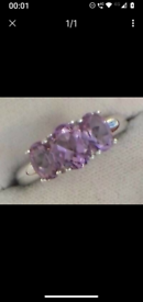 LADIES RING INSET WITH 3 GENUINE AMETHYSTS SIZE P THE RING IS IN EXC