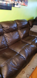 Three seater sofa, two armchairs and a footstool