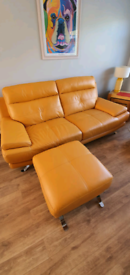 2 x mustard leather sofas and foot stool